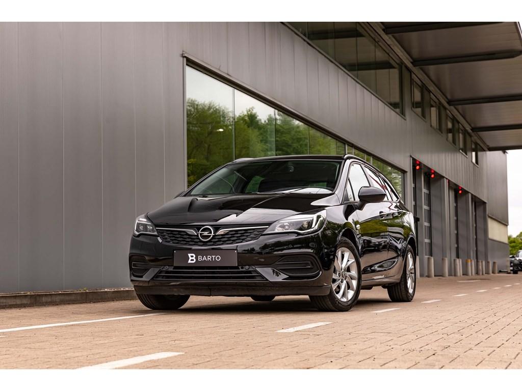 Tweedehands te koop: Opel Astra Zwart - Sports Tourer Edition 12 Benz 110pkNaviParkeersensAirco
