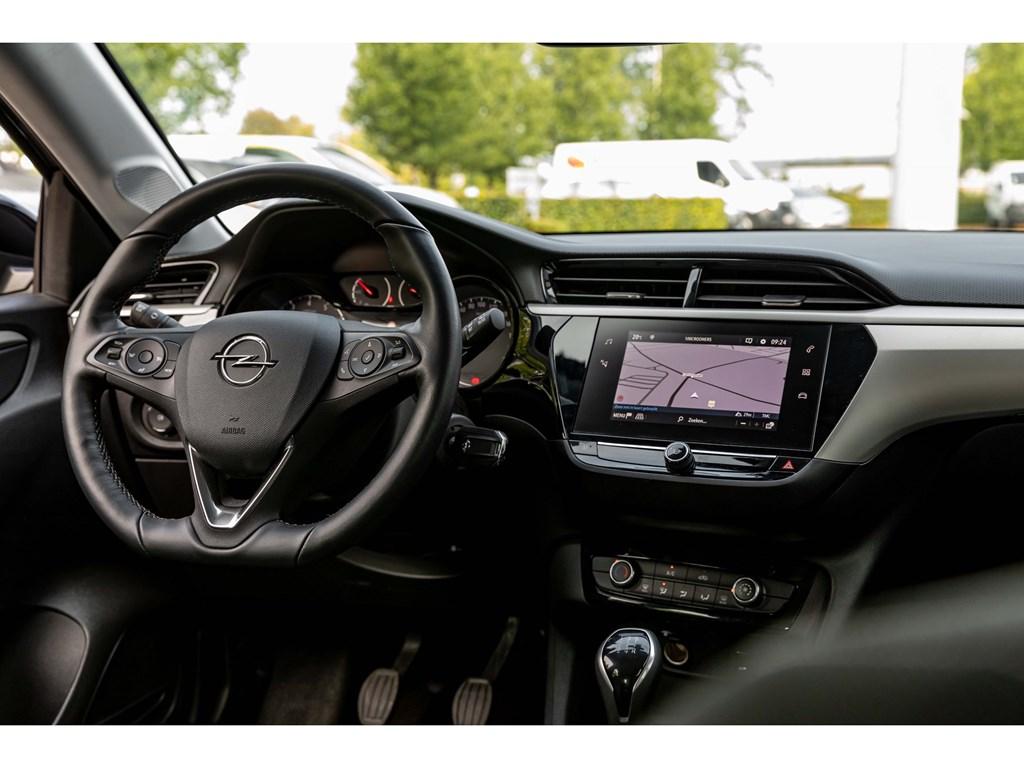 Tweedehands te koop: Opel Corsa Grijs - 12Benz 75pkEditionNaviParkeersensAirco