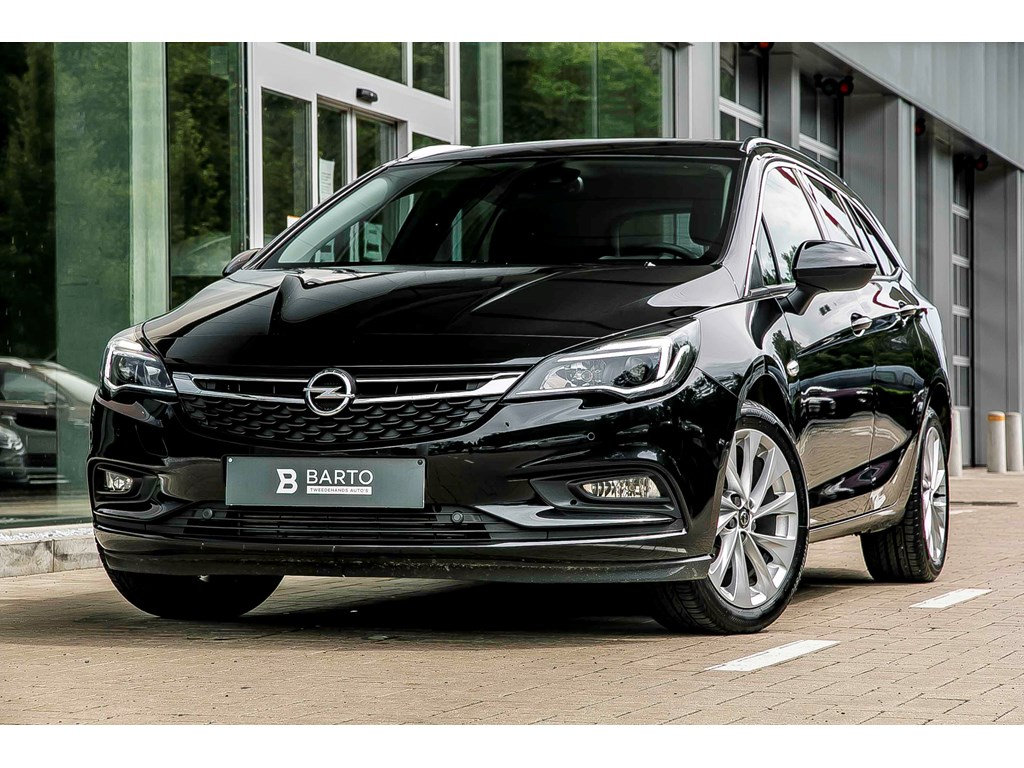 Tweedehands te koop: Opel Astra Zwart - Sports Tourer Innovation - 14 Turbo Benz 150pk - Navi - Camera - Dodehoeksens