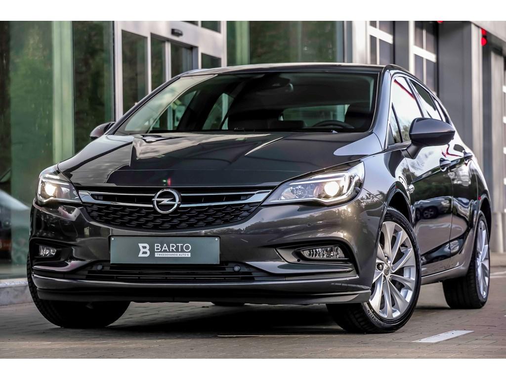 Tweedehands te koop: Opel Astra Grijs - 14b Turbo 125pk - Aut Airco - Navi - Camera - Dodehoeksens - Aut Inparkeren -