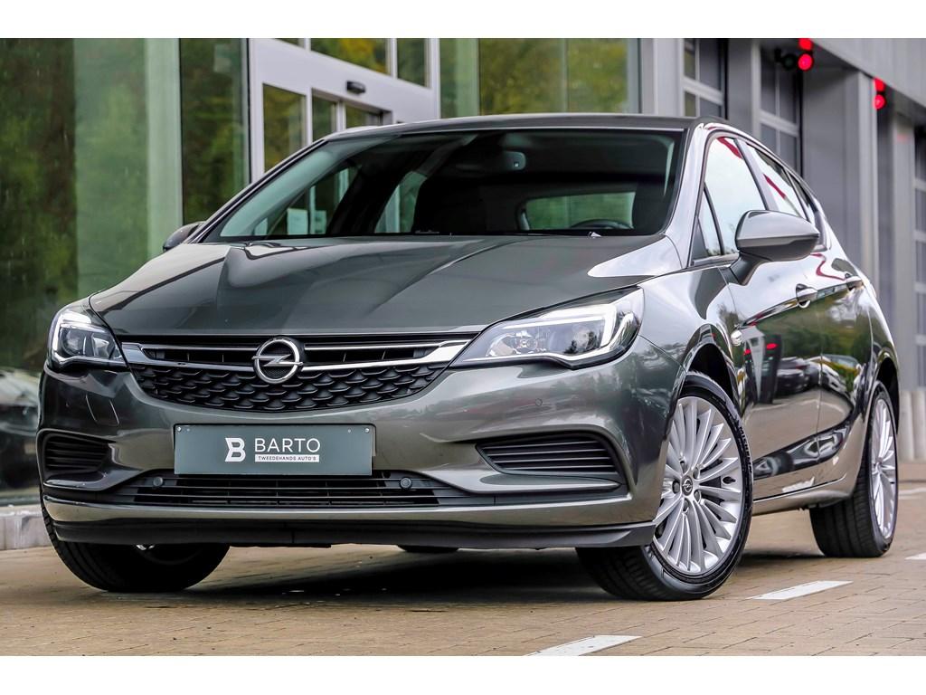 Tweedehands te koop: Opel Astra Grijs - 14b 125pk - 5d - Navi - Airco - Bluetooth -