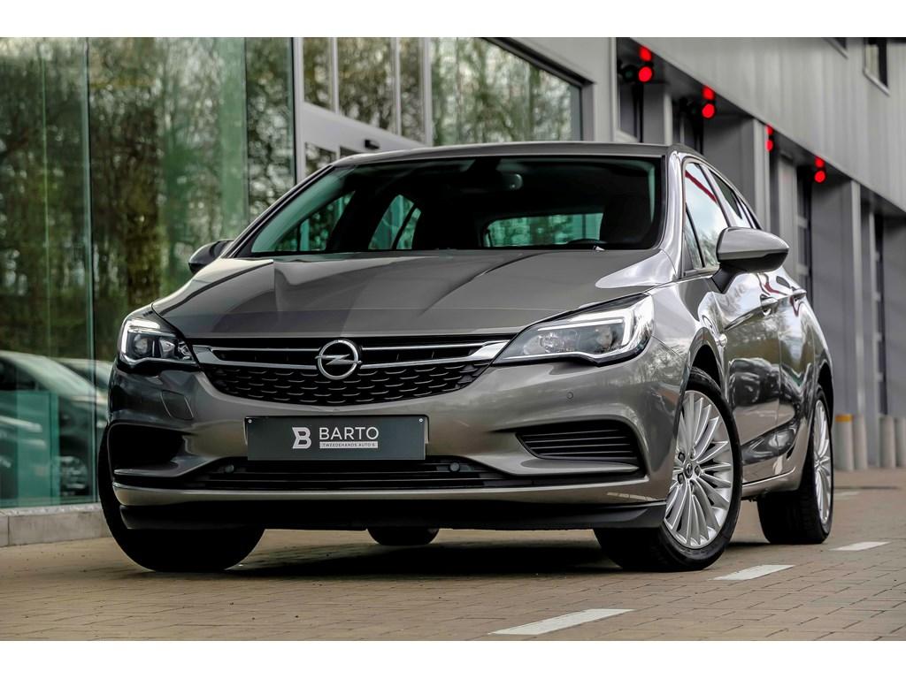 Tweedehands te koop: Opel Astra Grijs - 10b 105pk - Automaat - Navi - Airco - Parkeersens va - Auto lichten -