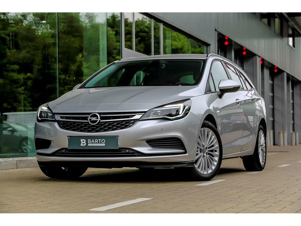 Tweedehands te koop: Opel Astra Zilver - 10 Turbo 105pk - Navi - Airco - Bluetooth - Cruisectrl -