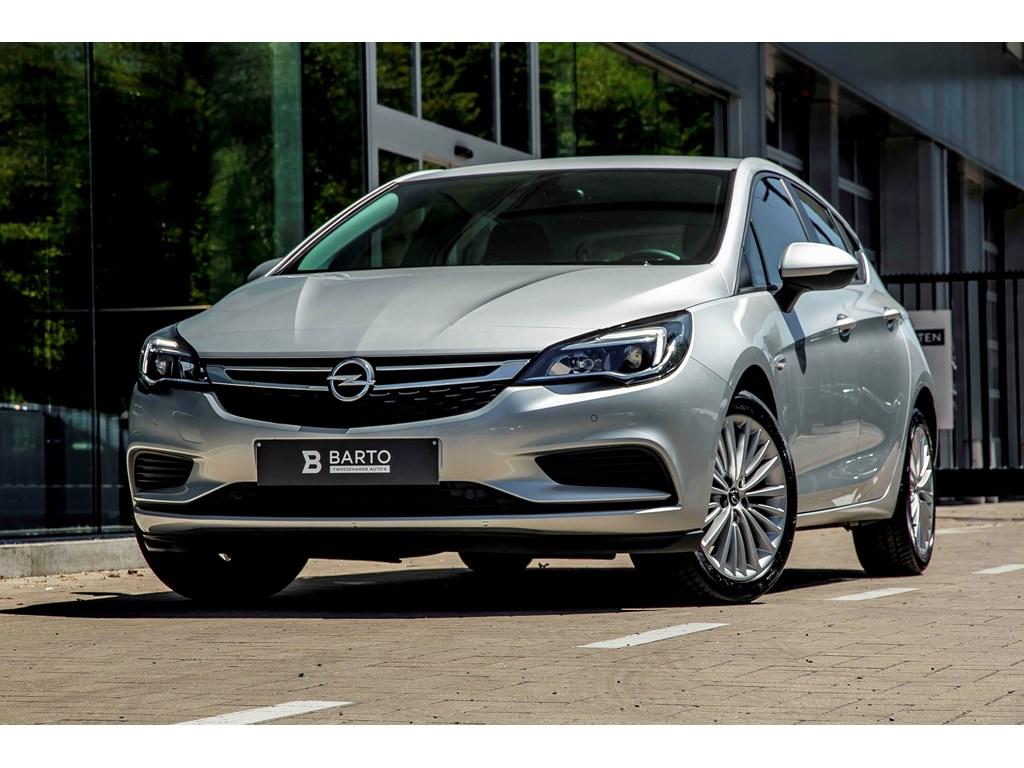 Tweedehands te koop: Opel Astra Zilver - 14b 100pk - Navi - Airco - Bluetooth - Auto Lichten - Regensens -