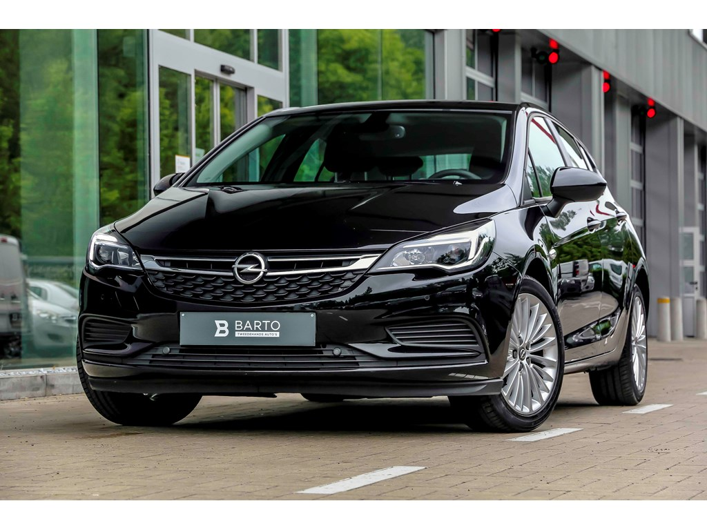 Tweedehands te koop: Opel Astra Zwart - 14b 100pk - Navi - Airco - Cruisectrl - Bluetooth -