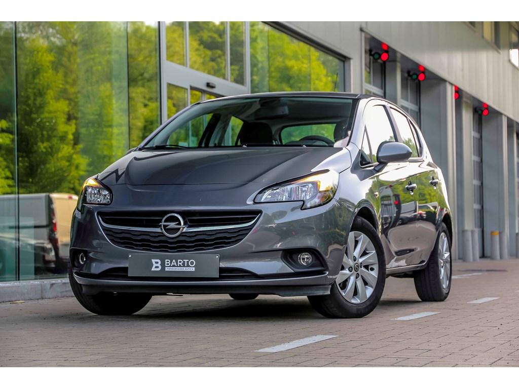 Tweedehands te koop: Opel Corsa Grijs - 12b 70pk - Airco - Bluetooth - Auto lichten - Regensens -