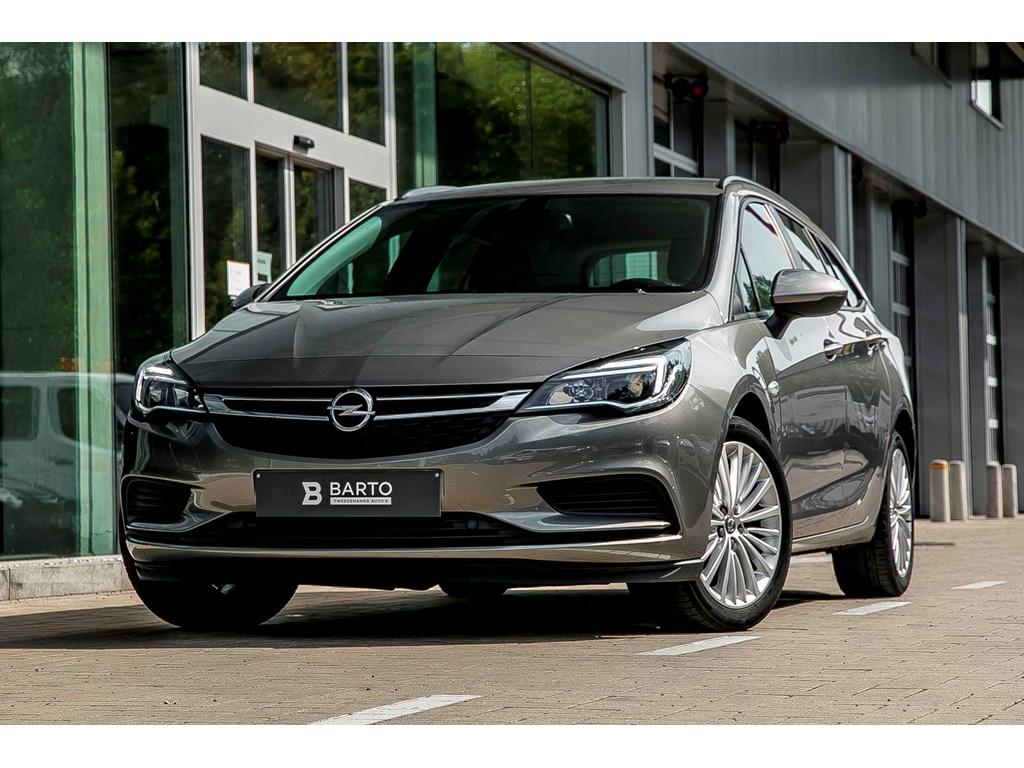 Tweedehands te koop: Opel Astra Grijs - 10b Turbo 105pk - Navi - Parkeersens va - Cruise Control - Bluetooth -