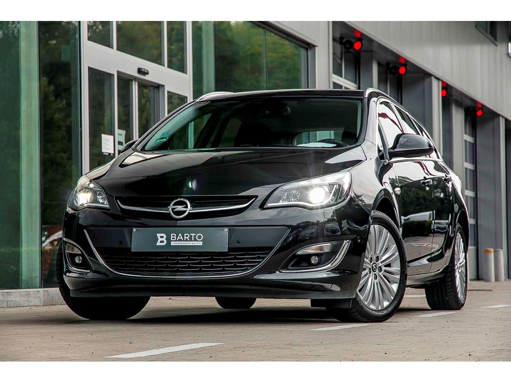 Tweedehands te koop: Opel Astra Zwart - 14b Turbo 120pk - Xenon - Leder - Navi - Dode Hoeksens -
