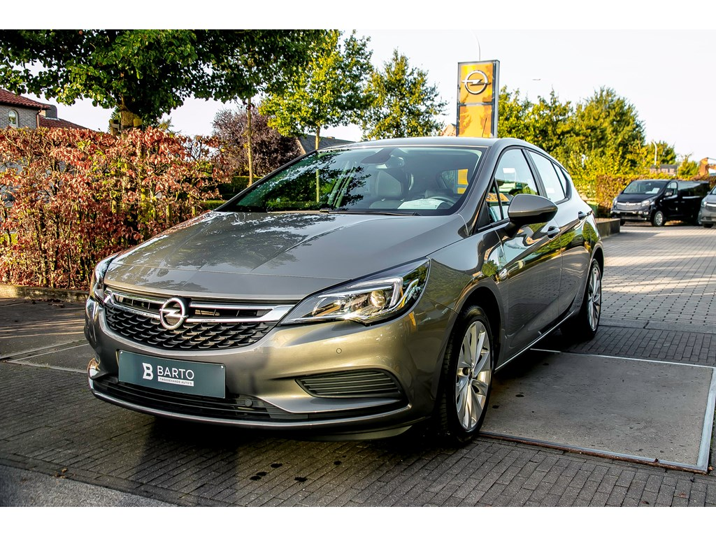 Tweedehands te koop: Opel Astra Grijs - 5-Deurs Edition 14 Turbo benz 125pk - Airco - Parkeersens - Weinig kms