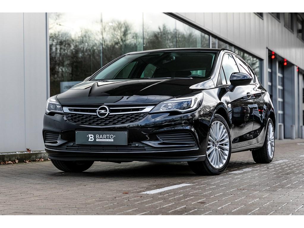 Tweedehands te koop: Opel Astra Zwart - 14b 100pk - Navi - Airco - Parkeersens va - Weinig kms
