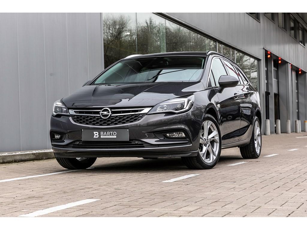 Opel-Astra-Grijs-10b-105pk-Navi-Camera-Auto-Parkeerhulp-Dode-hoeksens-