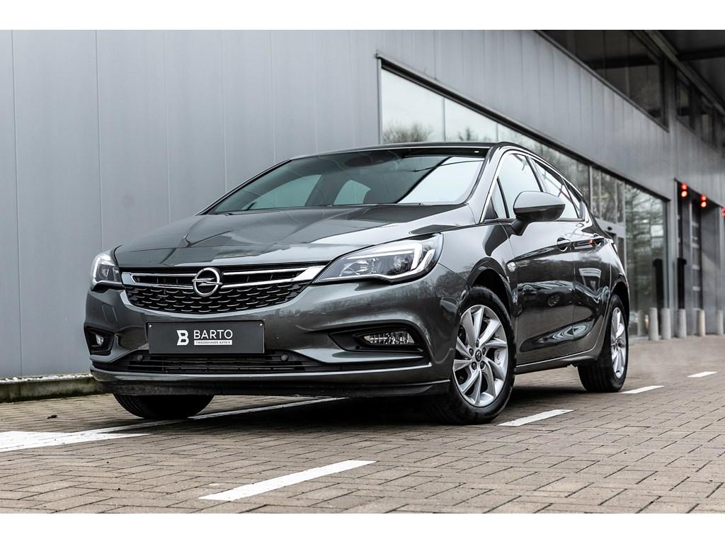 Tweedehands te koop: Opel Astra Grijs - 5 Deurs Dynamic 14 Turbo 150pk - AUTOMAAT - Dodehoek - Camera - Botswaarschuwing -