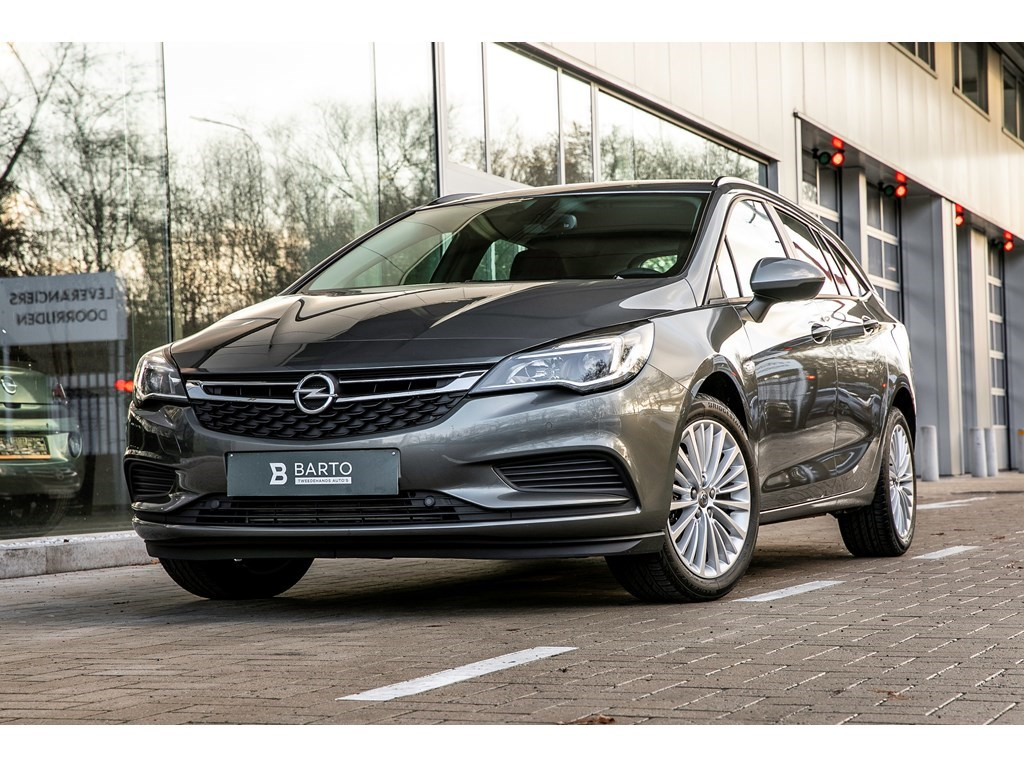 Tweedehands te koop: Opel Astra Grijs - Sports Tourer Edition 14 Turbo Benz 125pk Navigatie Parkeersens alu velgen