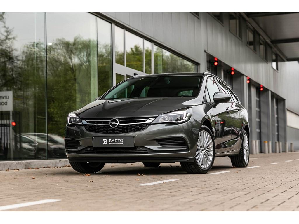 Tweedehands te koop: Opel Astra Grijs - Break - 14T benz 150pk-Autom-Navi-Airco-Parkeersens