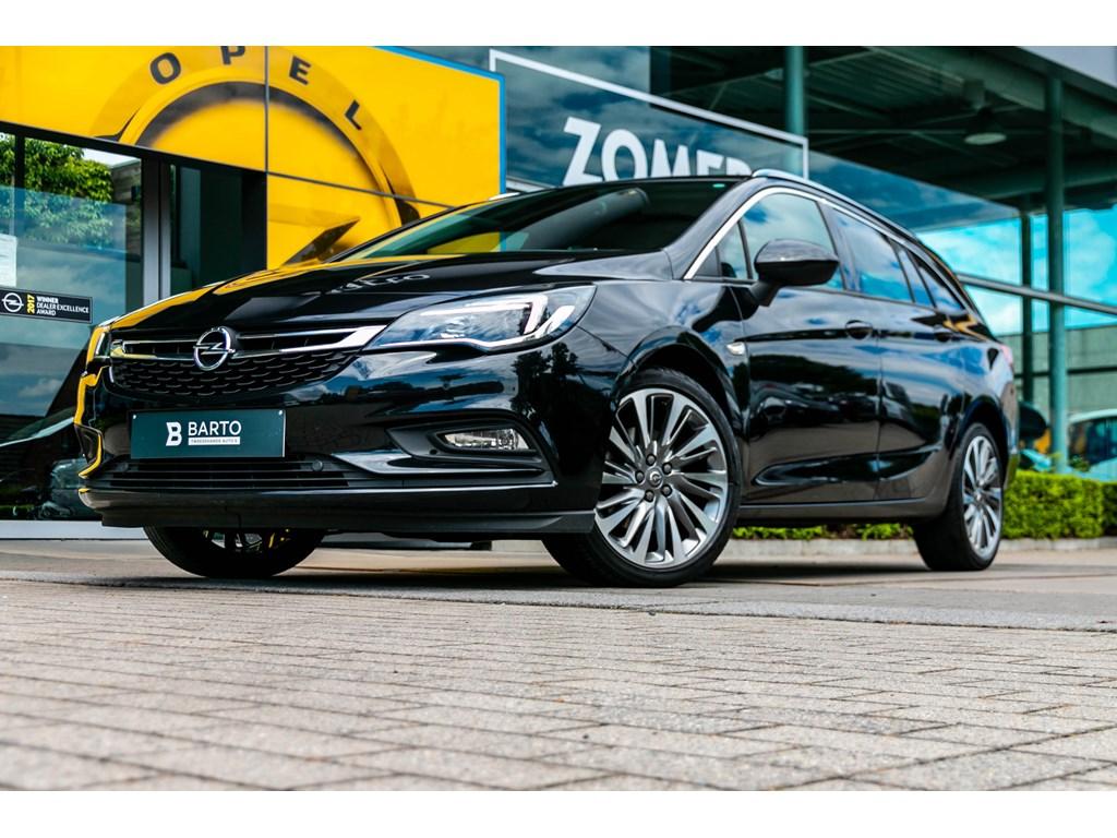 Tweedehands te koop: Opel Astra Zwart - Sports Tourer 16 CDTi Innovation - BiColor velgenCameraNaviParkeersens