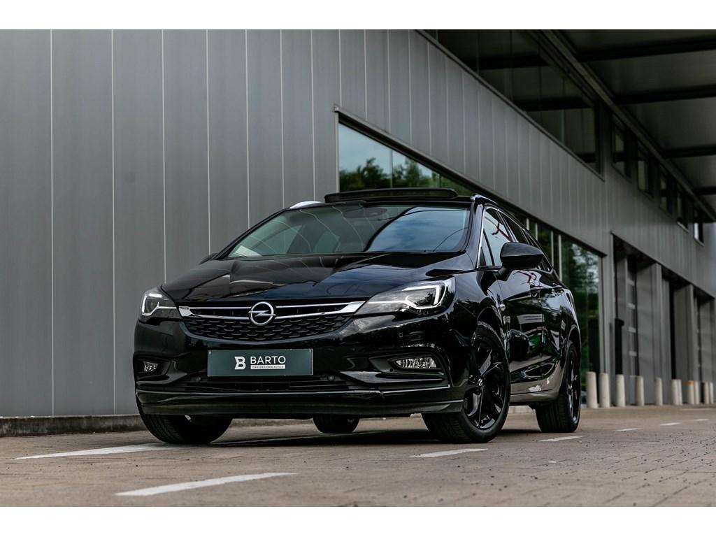 Tweedehands te koop: Opel Astra Zwart - Benz 125pkLederMassagezetelsCameraElektr Koffer