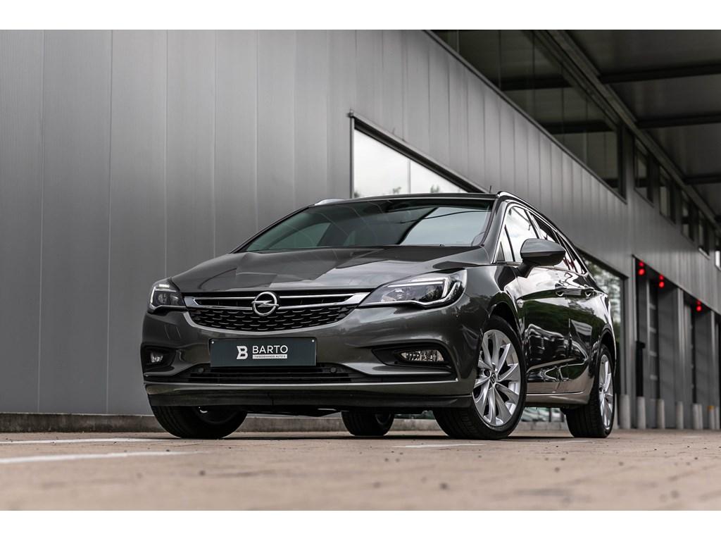 Tweedehands te koop: Opel Astra Grijs - Sports Tourer Innovation 14 Turbo Benz AUTOMAAT 150pk - Navi - Camera - Winterpack