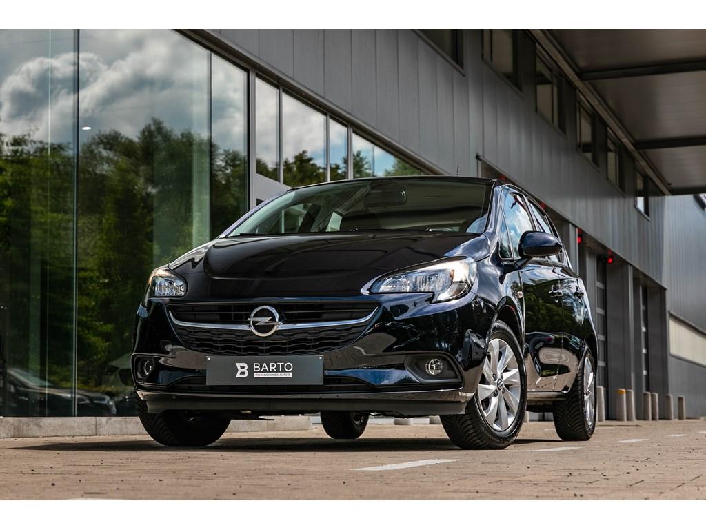Tweedehands te koop: Opel Corsa Blauw - 12 benzAuto LichtenRegensensorUSBWEINIG KMs