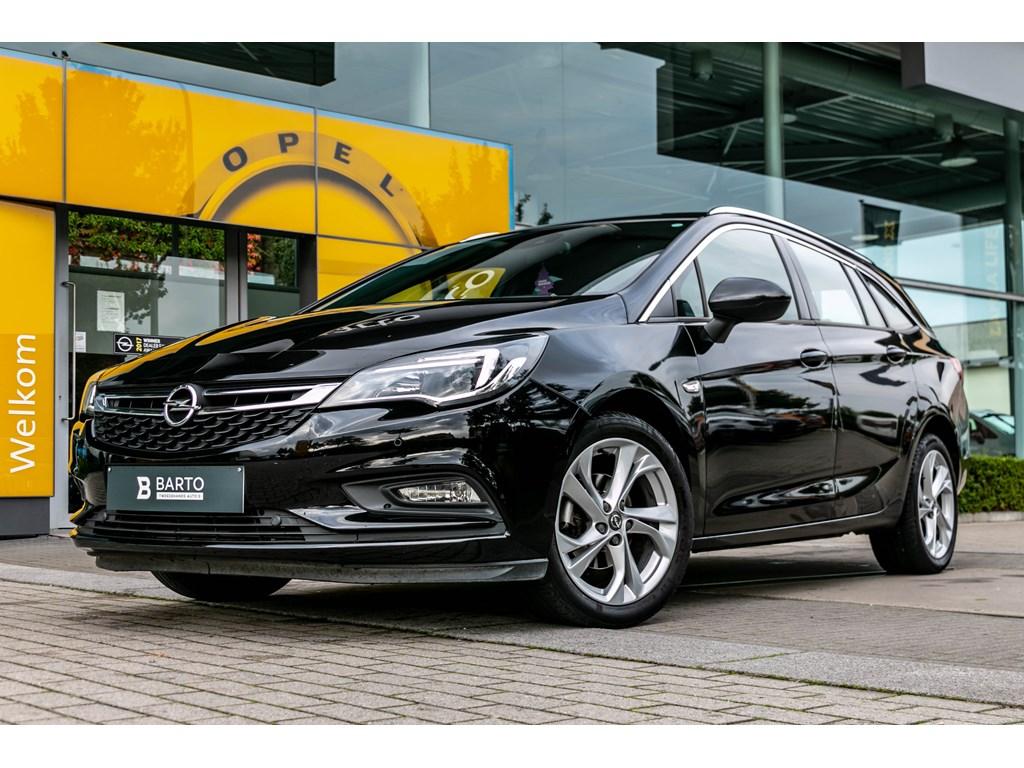 Tweedehands te koop: Opel Astra Zwart - Sports Tourer 14 Turbo 125pk Dynamic - ParkeersensNavi