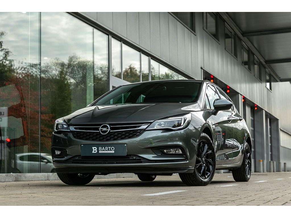 Tweedehands te koop: Opel Astra Grijs - 16D 136pkDynamicCameraOfflaneDodehoeksens