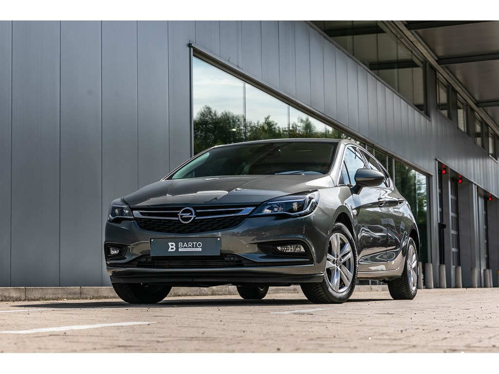 Tweedehands te koop: Opel Astra Grijs - Benz 105pkInnovationNaviKeylessAutoAircoOfflane