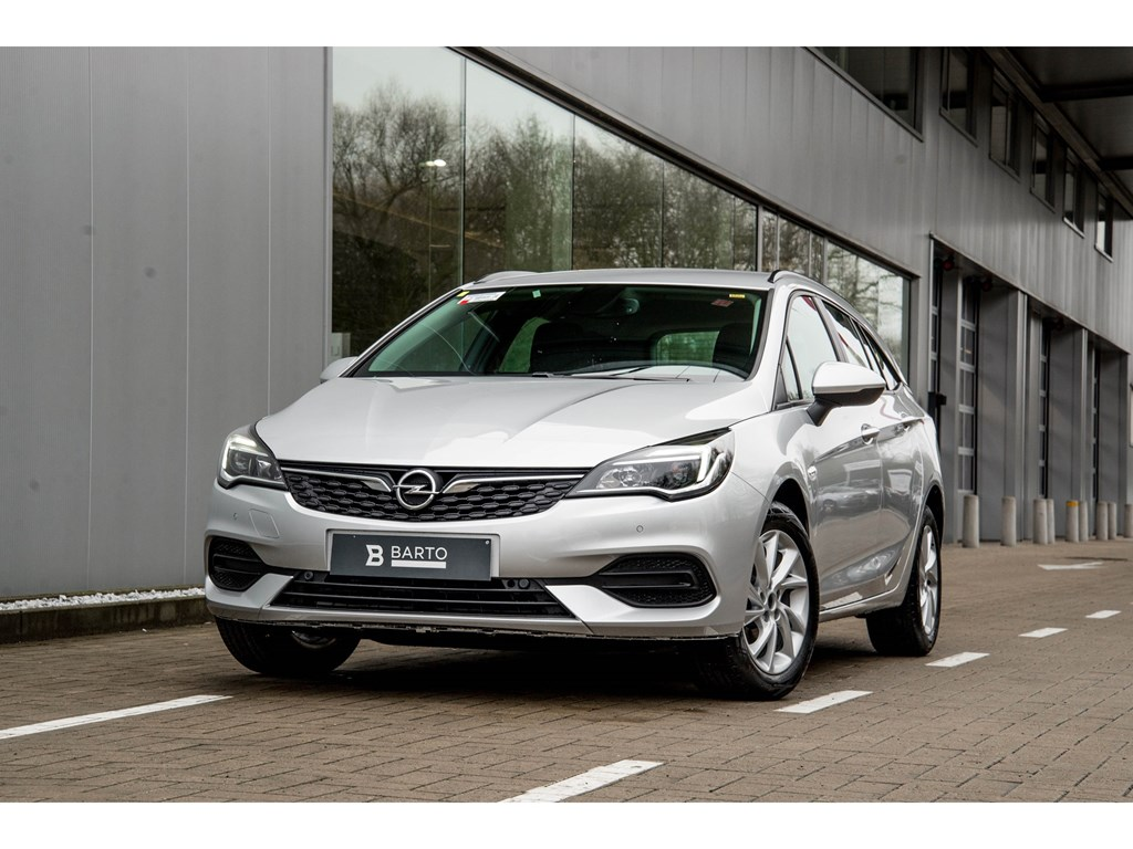 Tweedehands te koop: Opel Astra Zilver - Sports Tourer 15 Turbo D Diesel 122pk SS Manueel 6 - Edition - Nieuw