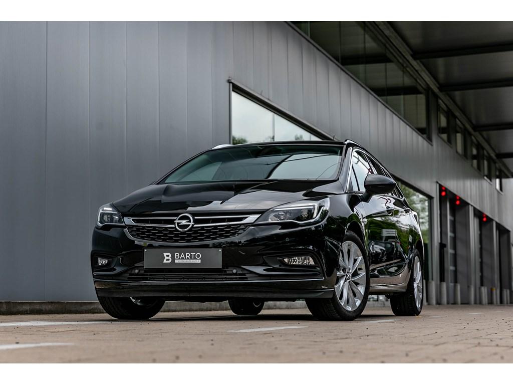 Tweedehands te koop: Opel Astra Zwart - Sports Tourer 14 Turbo 150pk Innovation NaviCameraDodehoek