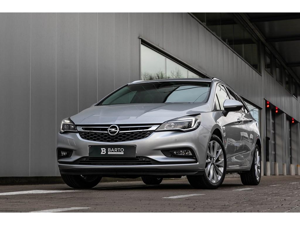 Tweedehands te koop: Opel Astra Zilver - Sports Tourer 14 Turbo 150pk Innovation NaviCameraDodehoek