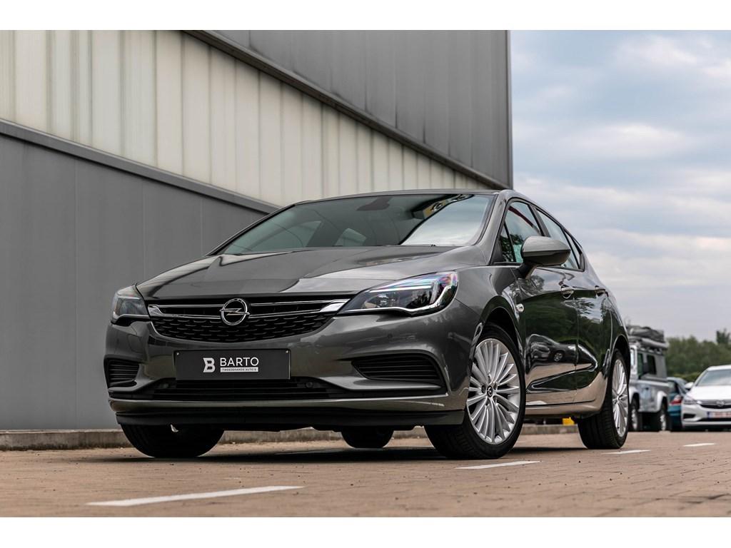 Tweedehands te koop: Opel Astra Grijs - Benzine - Navigatie - Parkeersens VA - Airco - Bluetooth -