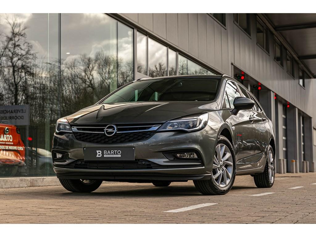 Tweedehands te koop: Opel Astra Grijs - 110pk Grote navi Ergonom Zetels NIEUW