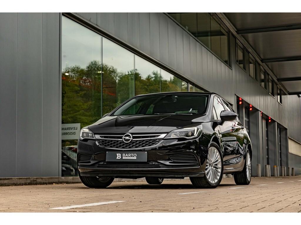 Opel-Astra-Zwart-14-TurboParkeersensAircoNaviAuto-LichtenRegensens