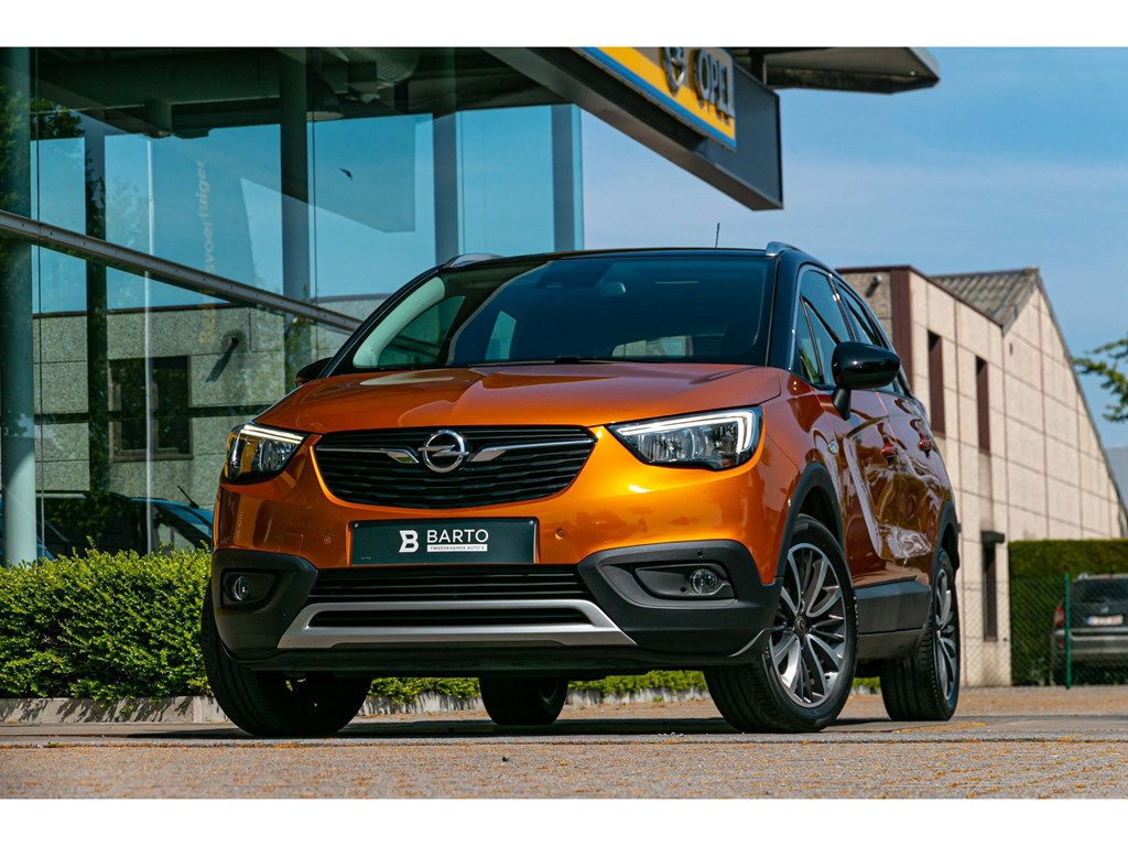 Tweedehands te koop: Opel Crossland X Oranje - 12benzInnovationAircoNaviHeadupdisplayParkeersens