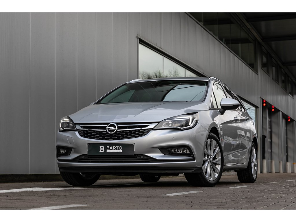 Tweedehands te koop: Opel Astra Zilver - Sports Tourer 14 Turbo 150pk Innovation NaviCameraDodehoek