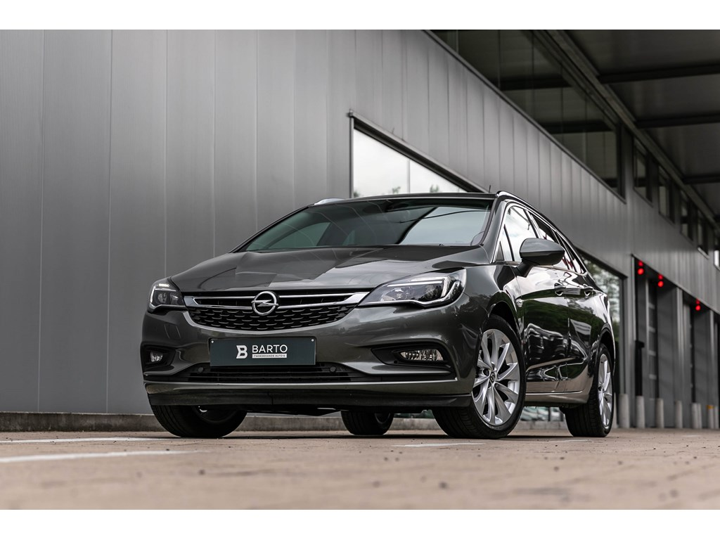 Tweedehands te koop: Opel Astra Grijs - Sports Tourer Innovation 14 Turbo Benz 150pk - Navi - Camera - Dodehoek -