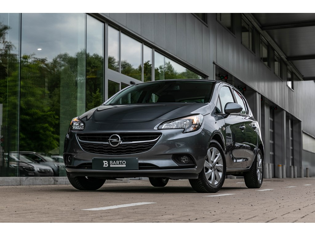 Tweedehands te koop: Opel Corsa Grijs - 12 BenzNavigatieAlu velgenAirco
