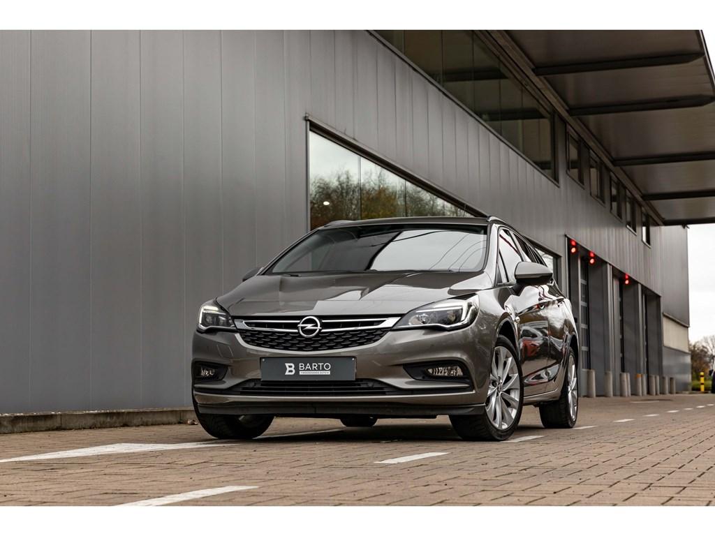 Tweedehands te koop: Opel Astra Grijs - 14 TurboParkeersens vaAuto lichtenRegensensAircoGetint glas