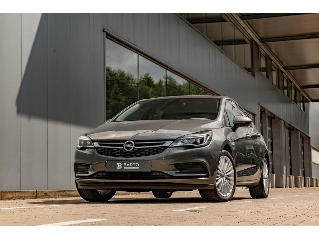Tweedehands te koop: Opel Astra Grijs - Benz 90pkNaviAircoParkeersensAutoLichtenRegensens