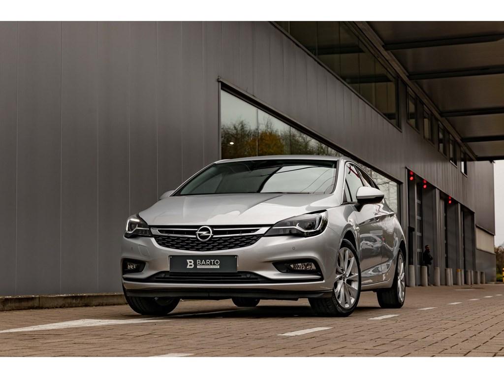 Tweedehands te koop: Opel Astra Zilver - 10T benzCameraVolledige LederLEDMatrixOfflaneDodehoeksens