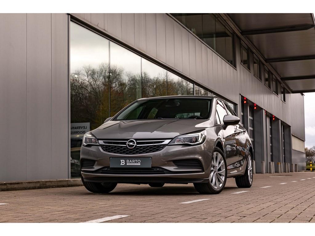 Tweedehands te koop: Opel Astra Grijs - Benz 105pkNaviAircoParkeersensAutoLichtenRegensens