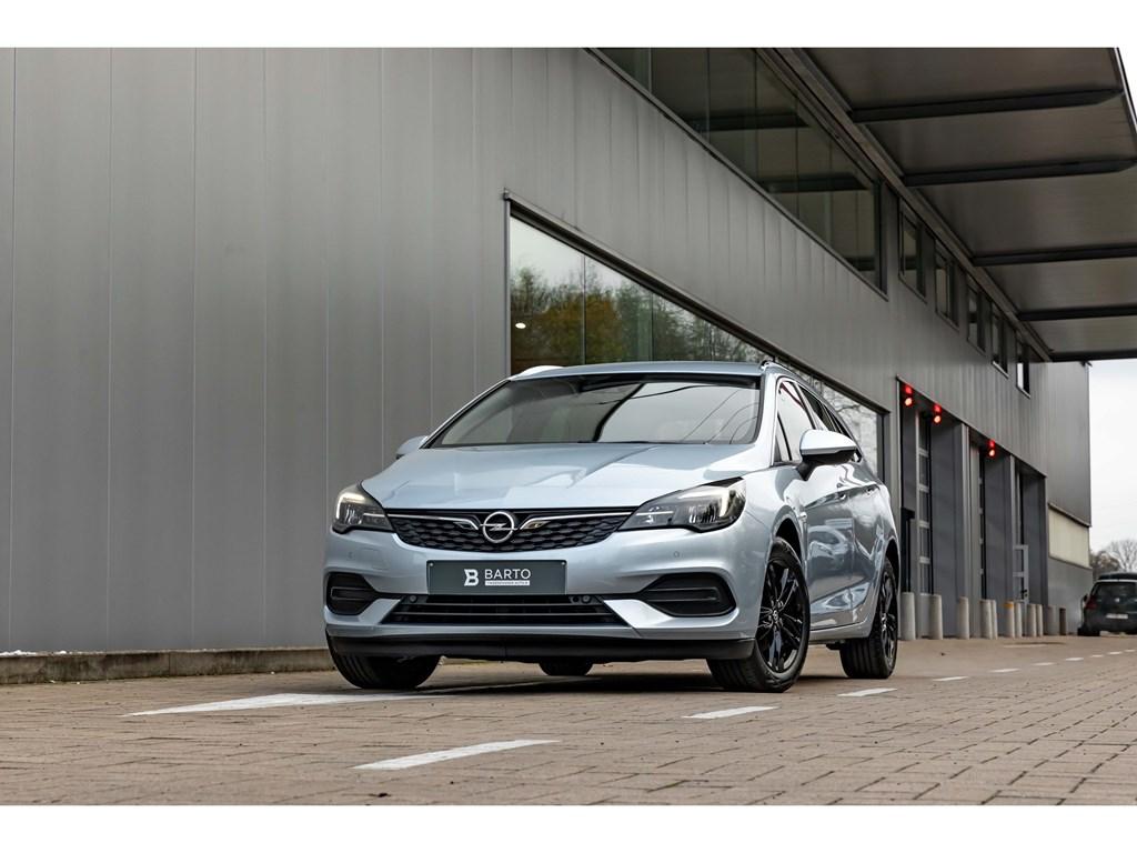 Tweedehands te koop: Opel Astra Zilver - 15d 122pk AT9Volledig LederGrote NaviLEDZwarte VelgenCameraDodeHoeksens