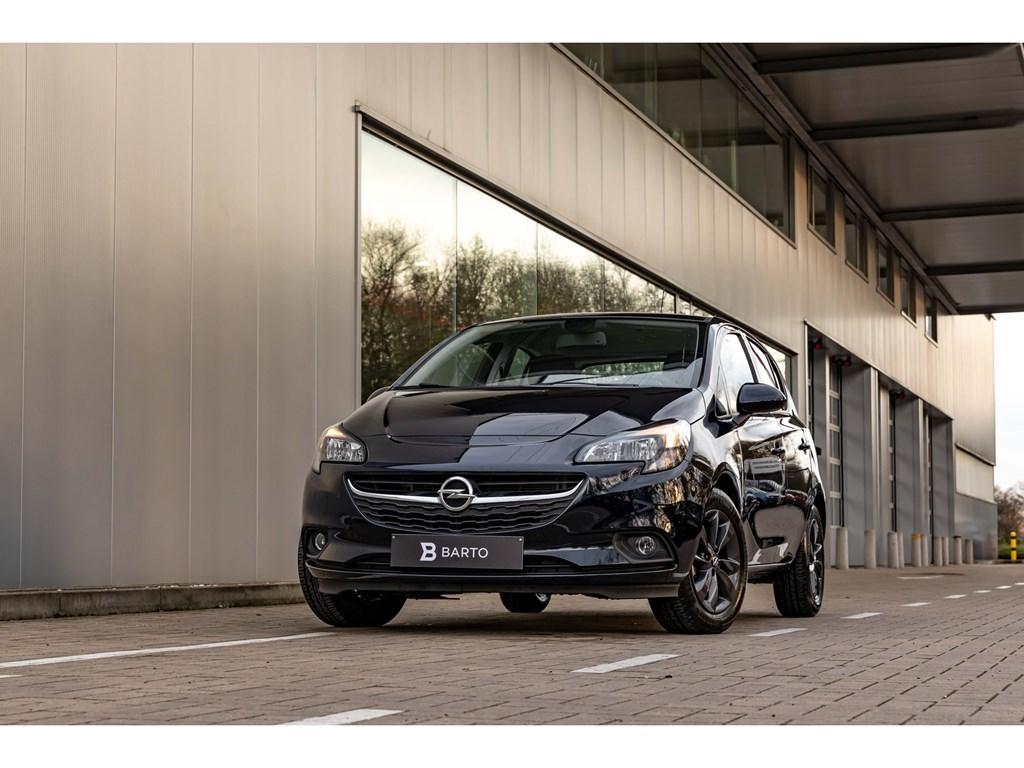 Tweedehands te koop: Opel Corsa Blauw - 12 benzAuto LichtenNaviAircoWEINIG KMs