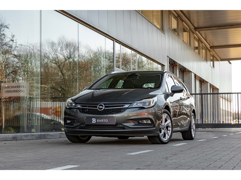 Tweedehands te koop: Opel Astra Grijs - 16Diesel AT InnovationCameraZetelverwarmDodehoeksens
