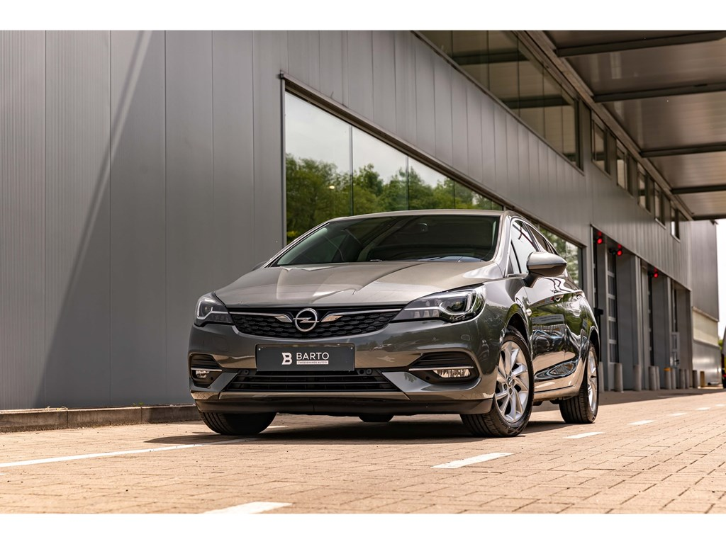 Tweedehands te koop: Opel Astra Grijs - 12Turbo BenzEleganceDirectiewagenLED MatrixNavi ProCamera